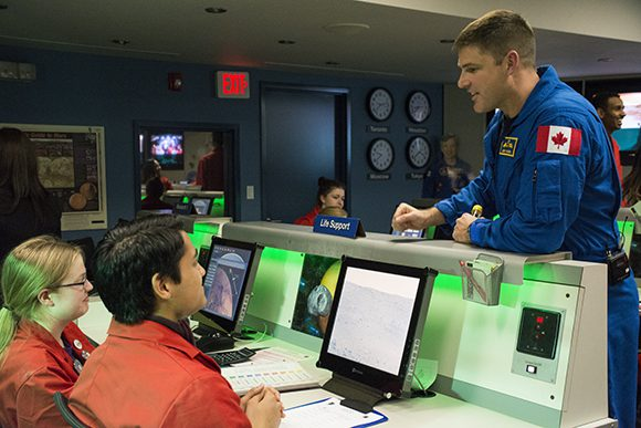 Astronaut Jeremy Hansen debriefs with students after leading a simulated mission to Mars.