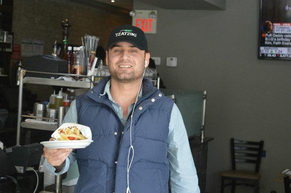 Tzatziki delivery driver Nisar Safi poses with Pape Street's favourite souvlaki