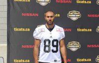 Spencer Watt posing at Ron Joyce Stadium, on the campus of McMaster University.