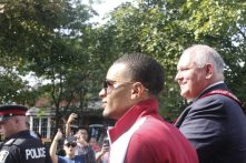 Andre De Grasse gets plenty of attention in his hometown of Markham Sunday during a parade in his honour.