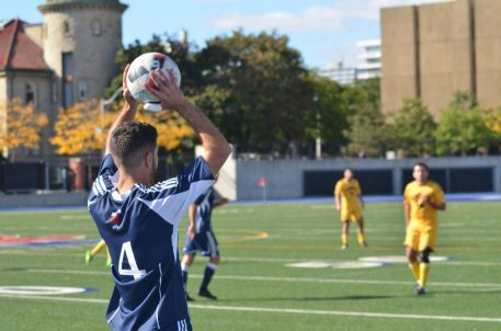 Defender Koosha Nazemi prepares to take a throw in against Queen's Gaels. Toronto coach Anthony Capotosto said his side were second best on Sunday.