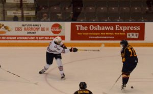 Serron Noel shoots the puck of a Colts defender in the Generals 4-2 victory
