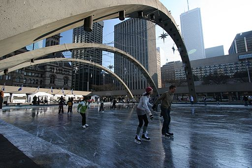 People skate at Toronto's Nathan Phillips Square.