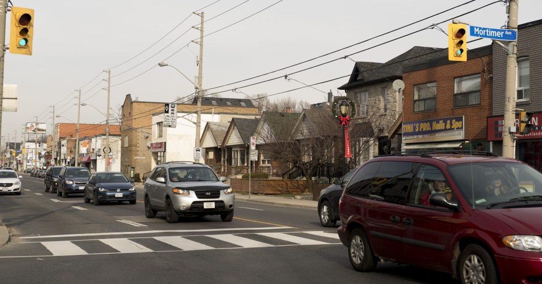 Vehicles driving down Pape Avenue