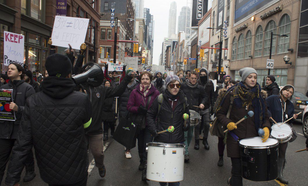 Protesters march to Dundas Square