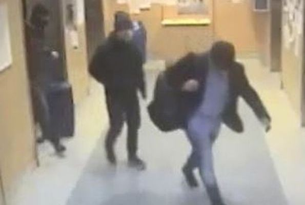 Three men are shown on surveillance footage after equipment heist