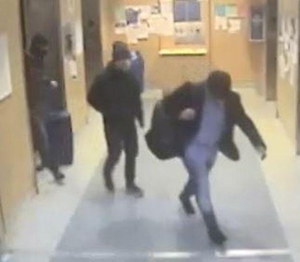 Three men are shown on surveillance footage after equipment heist