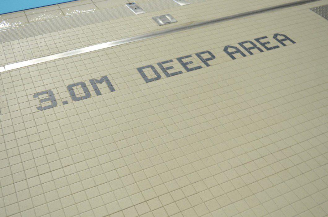 pool depth marker inside Pan Am pool building