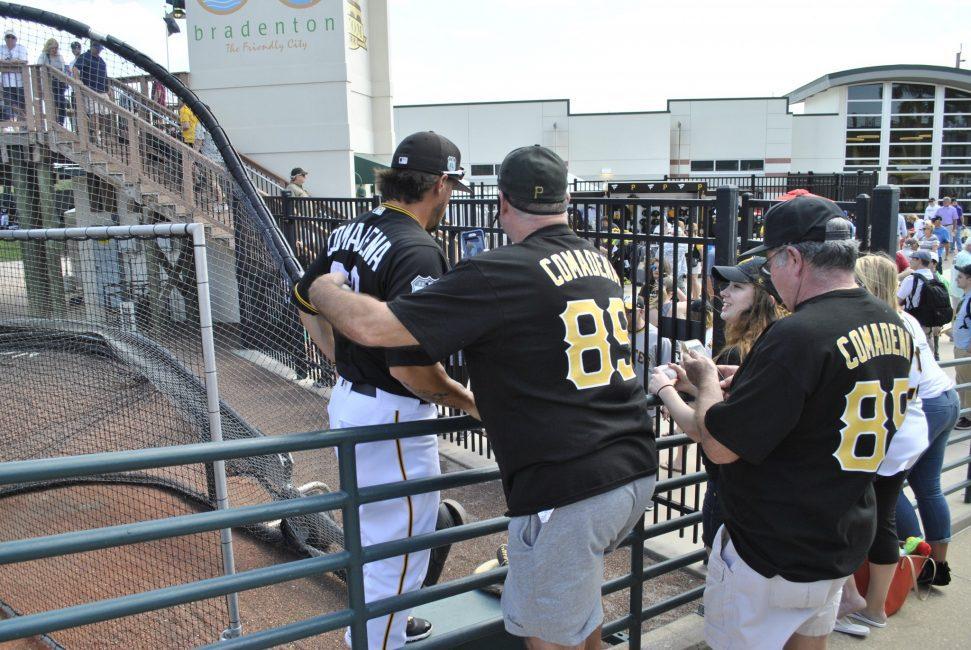 Fans with Pirates catcher Jordan Comadena