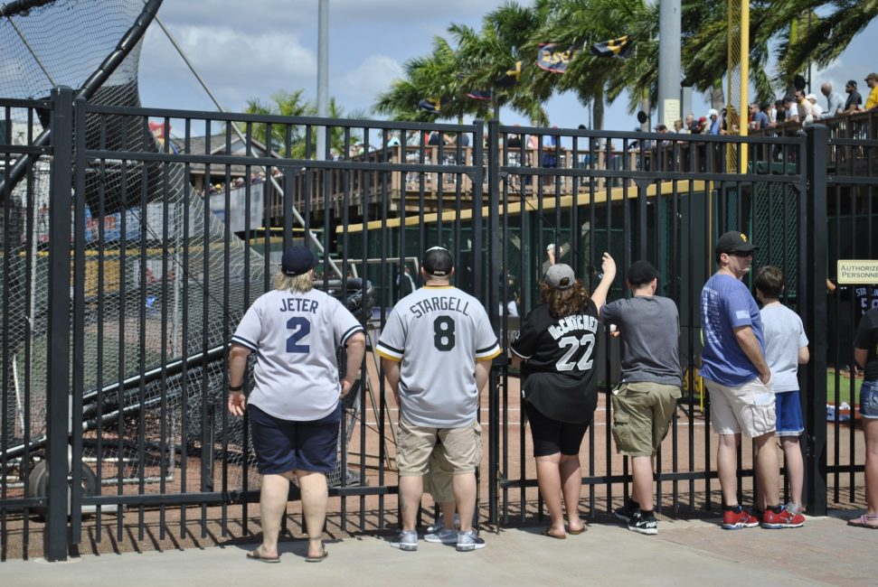 baseball fans at outfield fence