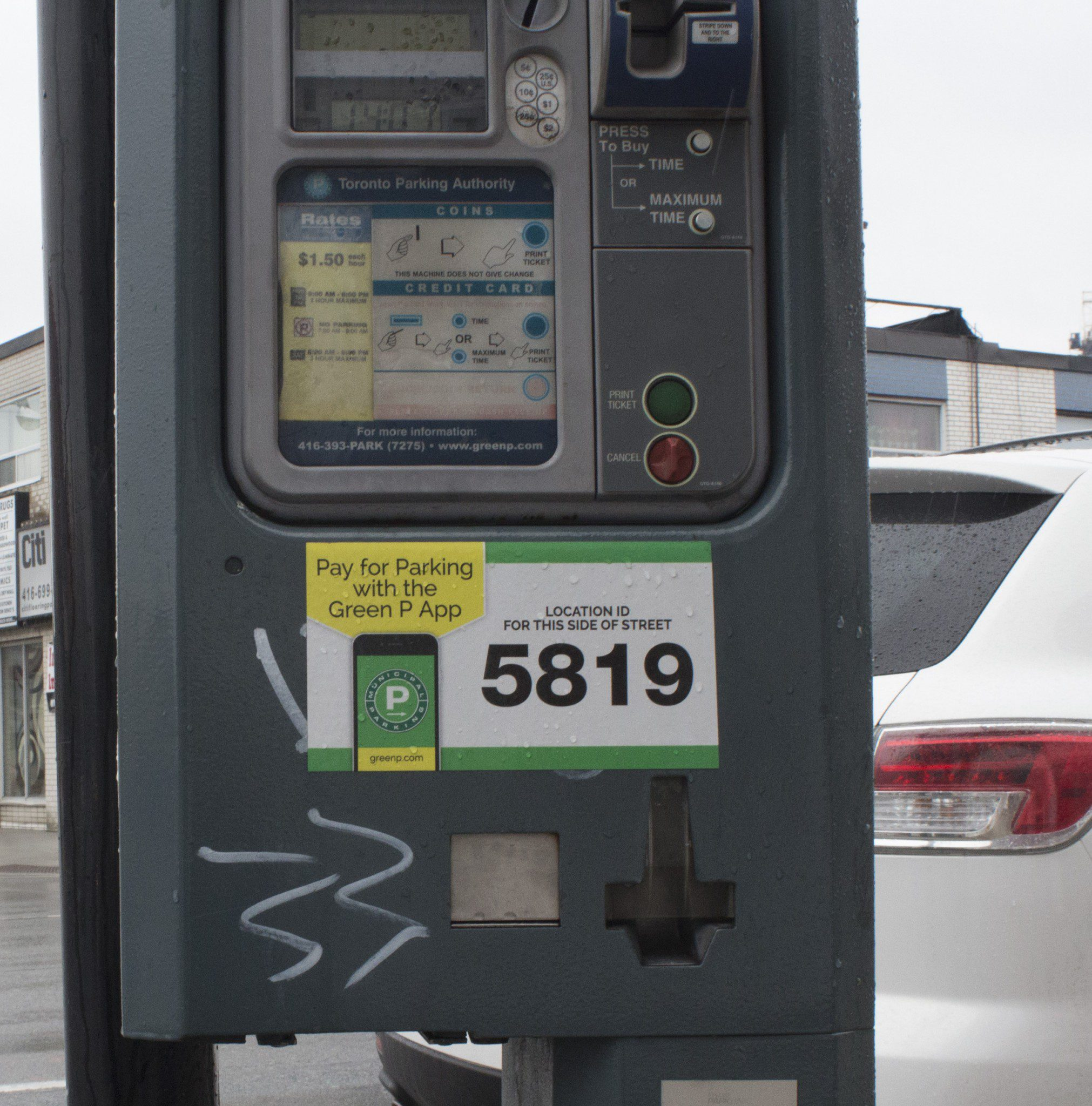sticker covers graffiti on parking meter