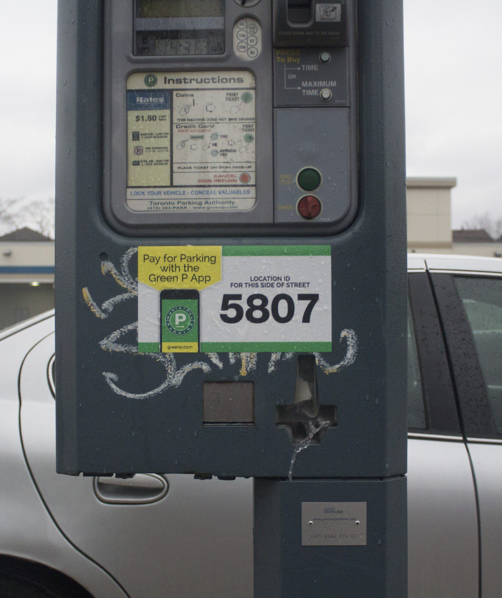 sticker covers graffiti on parking meter