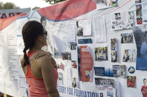 Julie Ly,39, looks over the stories on the board and calls the event an emotional experience.