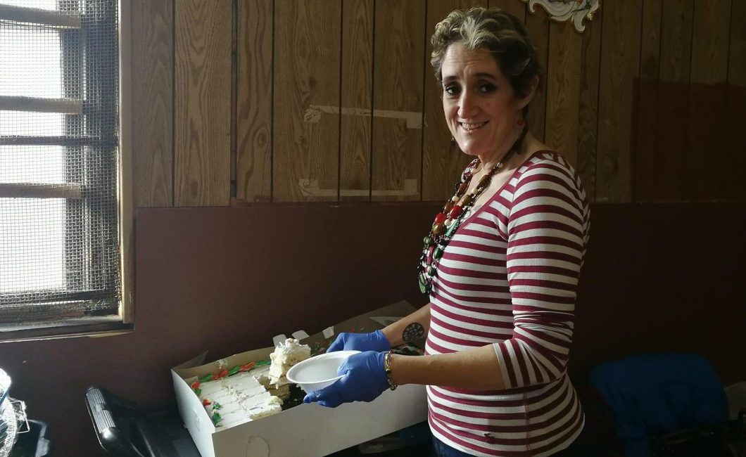 Woman handing cake