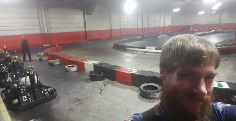 Matthew Hayley takes a picture of himself at the race track while standing in front of his go-kart.