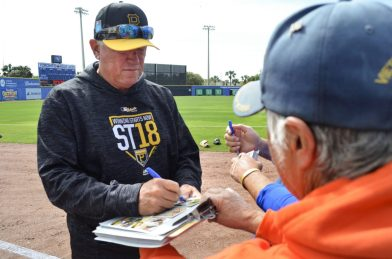 Clint Hurdle signs baseball cards for fans at Dunedin Stadium. (Cam Newell photo)