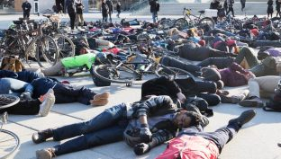 Demonstrators at the die-in held in front of city hall on March 26, 2018. They want stricter laws enforced and better protection for pedestrians and cyclists.