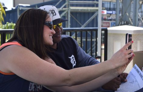 A fan takes a selflie with Ramon Santiago