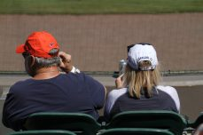 Two Detroit Tigers fans sit first row, behind home plate. The woman sports a Lakeland, Fla. cap. Lakeland has been the Spring Training home of the Tigers since 1966.(Nikolas Marsiglio photo)