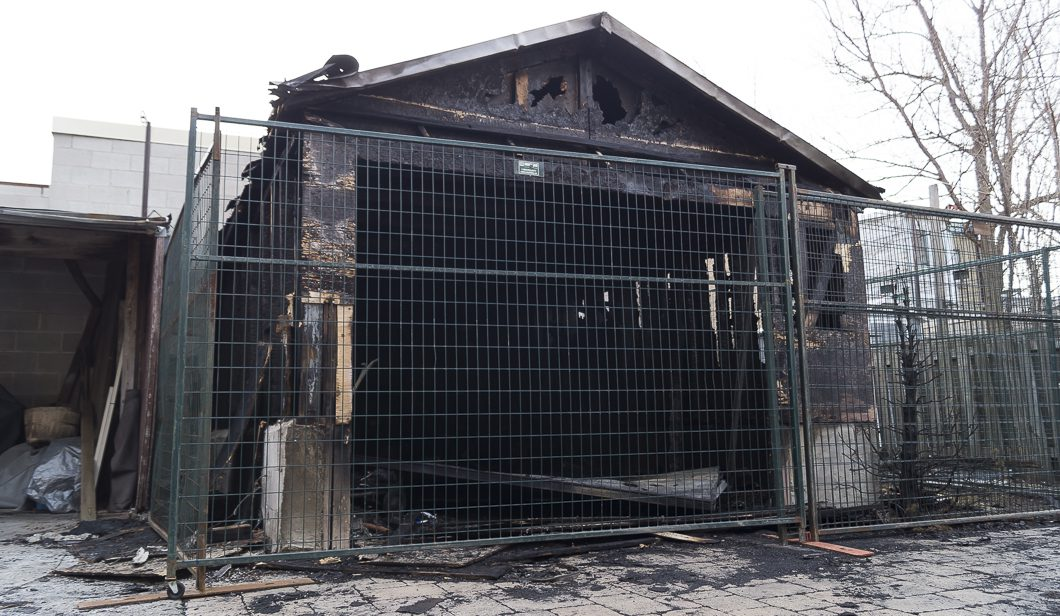 A detached garage sits charred at a residence on Coleridge Avenue after it caught fire early Friday morning.