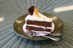 Delicious piece of carrot cake on a plate.