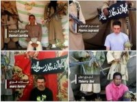 Combination of still images from a video released April 26, 2011 on Islamist internet forums by Al Qaeda's north African branch shows French hostages the group kidnapped in Niger in September.