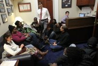 A staff member tries to head outside as activists wait in U.S. Rep. Jeb Hensarling's (R-TX) office for an unscheduled meeting with the congressman December 6, 2011 on Capitol Hill.