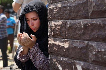 A woman prays with supporters of former Egyptian President Mohammed Morsi during Friday prayers