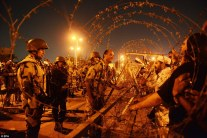 Barriers Egyptian soldiers face protesters backing President Morsi across a barricade of spiralling razor wire