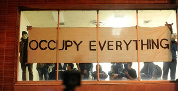 Occupy Oakland protesters claim a vacant building during a march downtown. Nov. 2 2011