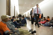 Protesters from the Occupy Wall Street movement fill the hallway outside of the offices of U.S. Senator Scott Brown (R-MA) (not pictured) on Capitol Hill in Washington December 6, 2011