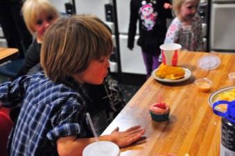 Tory and his vegan strawberry cupcake. Yum.