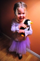 A penguin and a purple skirt.