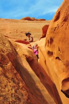 Aspen gets lowered down a little chute