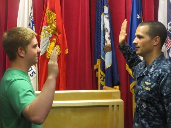 Marcus gets sworn into the Air Force.