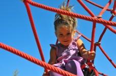 Tegan climbs the jungle ropes.