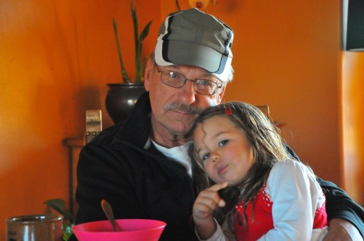 Tegan cuddles in with Grandpa.