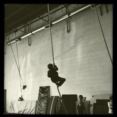 Climbing a rope.