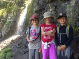 Rex, Tai, and Tory near a waterfall