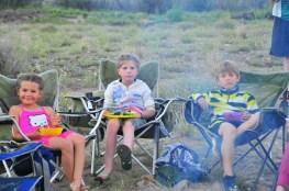 Tegan Soph and Tory enjoy dinner around the fire.