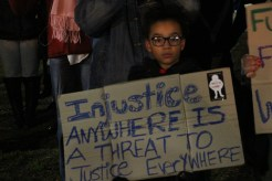 """Protesters shouted """"I can't breathe,"""" the last words uttered by Eric Garner, and put their hands up in a gesture that's become a symbol of the Ferguson protests. The protests were driven and organized mostly by social media; in addition to the Reddit thread, a Facebook event with information about the protest had over 7,700 RSVPs."""