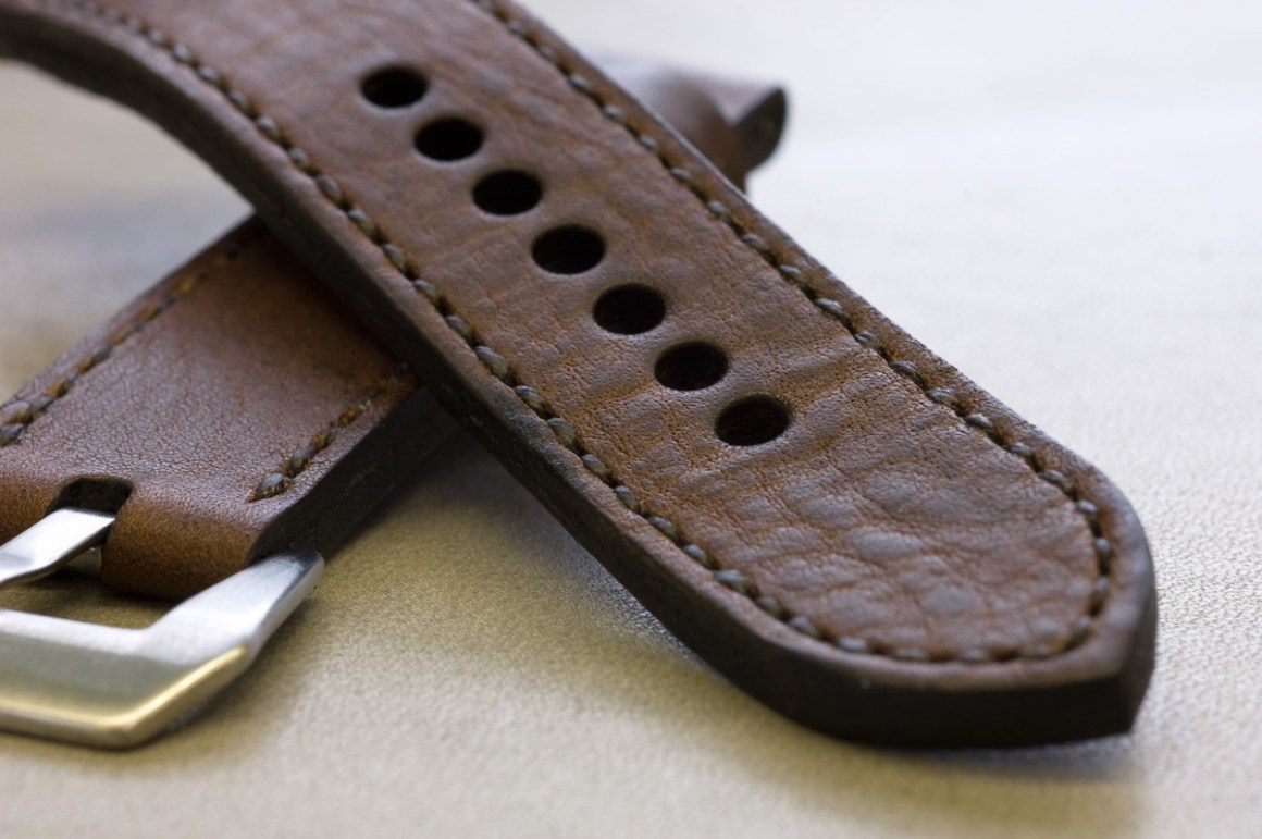 Horween Nut Brown leather with dark brown stitching.