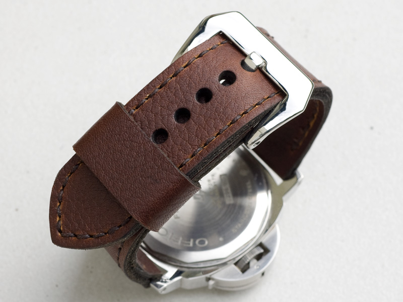 Shooting brake leather with dark brown stitching