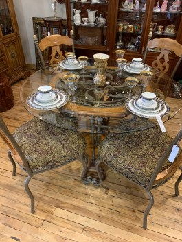 Look at this beautiful wrought iron table with wood accents!