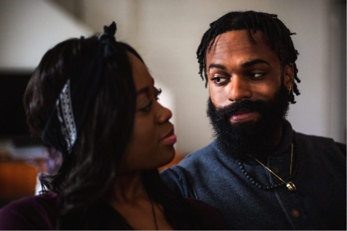 A man and a woman gaze into each others eyes
