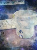 This is me with my 'new camera'... that is figuring out how to use my iPhone to take pics... on a coffee break from writing. Writing is a great hobby if you like staring at a blinking cursor and wishing you were dead lol So the coffee cup is from when hubby and I took a ceramics class together, the little character is his invention, his name is 'brainstorm' :)
