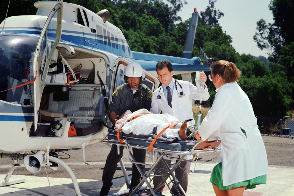 Emergency workers unloading a patient from a helocopter