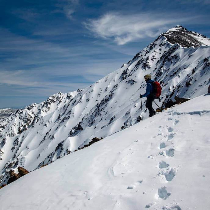 Jason peers down into Elderberry Canyon, Mt Tom's summit still impossibly distant.