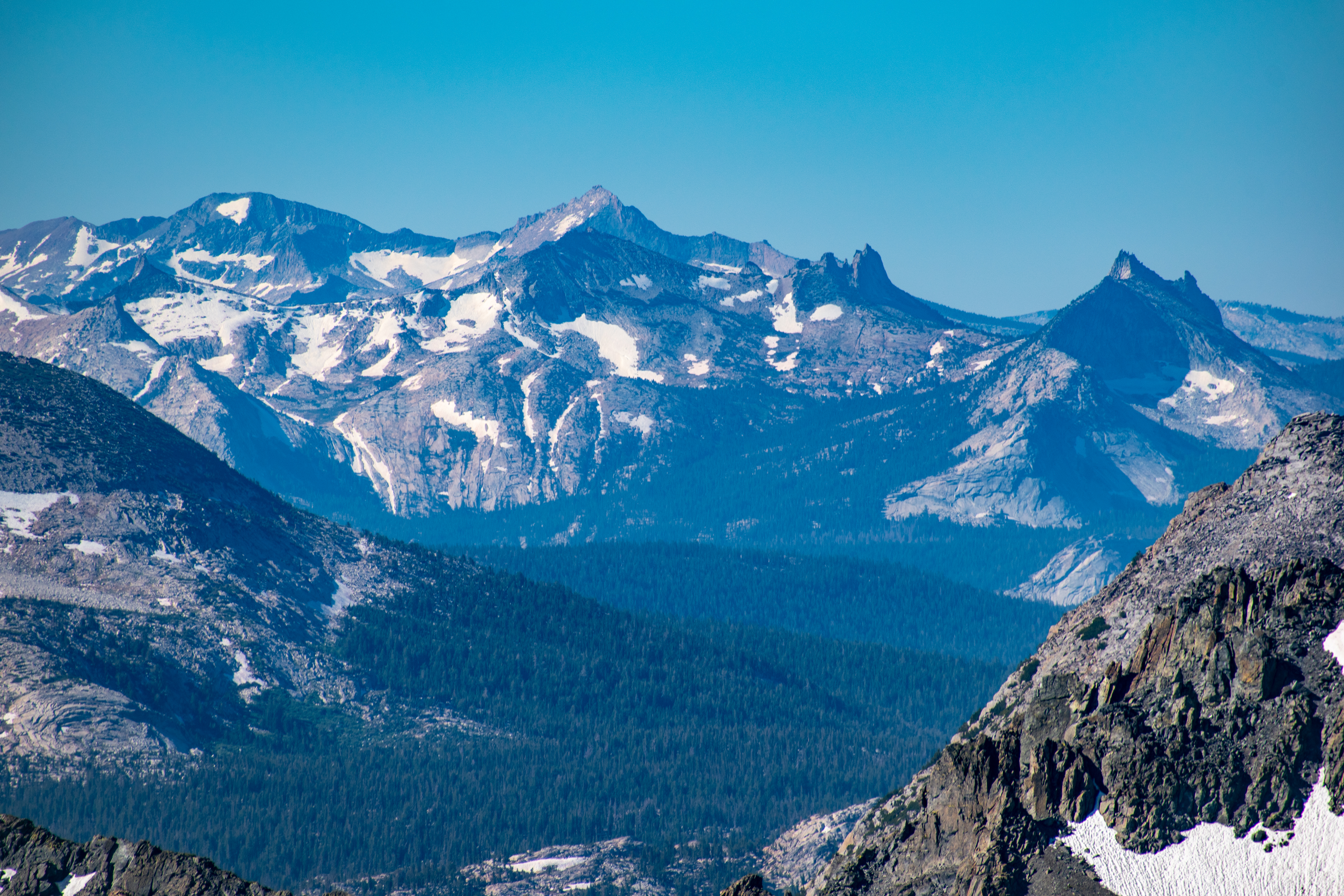 The Cathedral Crest, including Unicorn Peak, Cockscomb, Echo Ridge, Echo Peaks, and Cathedral Peak; Gray Peak and Mt Clark beyond.