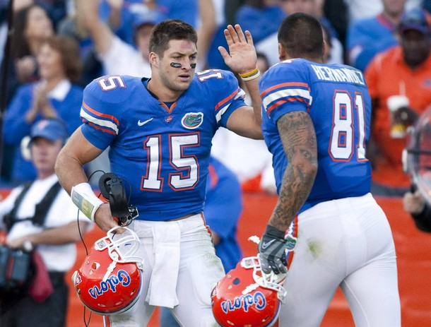 University of Florida's quarterback Tebow celebrates with Hernandez after throwing a touchdown pass during their NCAA football game against the University of Arkansas in Gainesville